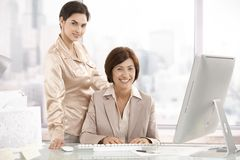 Portrait of senior executive woman with assistant Royalty Free Stock Photos