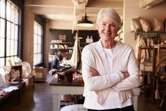 Portrait Of Senior Female Owner Of Gift Store Stock Photo