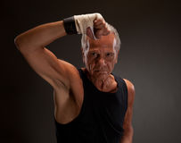 Portrait of a senior fighter with clenched fist Royalty Free Stock Photos