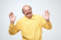 Portrait of senior happy man with hands lifted upwards stock photography