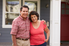Portrait Of Senior Hispanic Couple Standing Outside House Stock Images