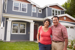 Portrait Of Senior Hispanic Couple Standing Outside House Royalty Free Stock Photos