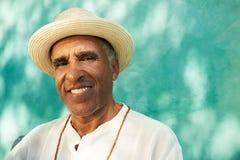 Portrait of senior hispanic man smiling at camera Stock Photos