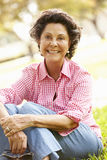 Portrait Of Senior Hispanic Woman Sitting In Park Stock Photos
