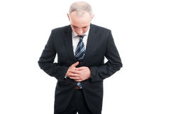 Portrait of senior holding his stomach like hurting Stock Photo