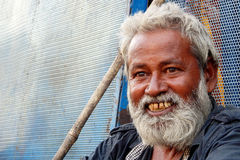 Portrait of Senior homeless poor Indian man seek help or alms at entrance of Hindu temple, Royalty Free Stock Image