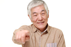 Portrait of  senior Japanese man decided on white background Stock Photo
