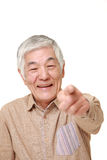 Portrait of  senior Japanese man decided on white background Stock Images