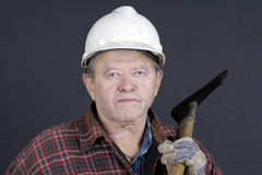 Portrait of senior logger on black Stock Images