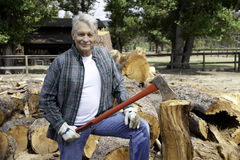 Portrait of senior lumber jack holding an axe Stock Photography
