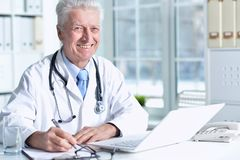 Portrait of  senior male doctor stock photography