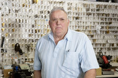 Portrait of a senior male owner of key store Royalty Free Stock Photos