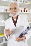 Portrait Of Senior Male Pharmacist Stock Photography