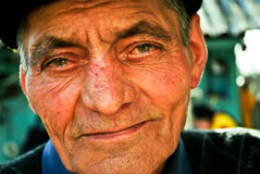 Portrait of senior man. Portrait of retired senior man with suntanned face and hat or cap Royalty Free Stock Photography