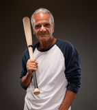Portrait of a senior man with a baseball bat Royalty Free Stock Photo