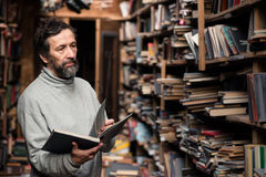 Portrait of senior man with beard on book market Royalty Free Stock Photography