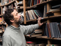 Portrait of senior man with beard on book market Stock Photography