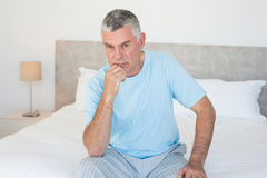 Portrait of senior man on bed Stock Images