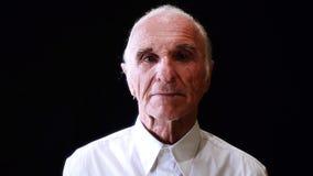 Portrait of senior man on black stock footage