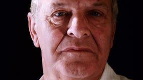 Portrait of senior man on black stock video footage