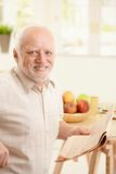 Portrait of senior man at breakfast Stock Images