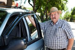 Portrait of Senior Man with Car Stock Image
