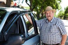 Portrait of Senior Man with Car. Portrait of senior man standing near car Stock Image