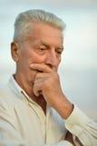 Portrait of senior man. Close up portrait of senior man holding hand on chin Royalty Free Stock Image