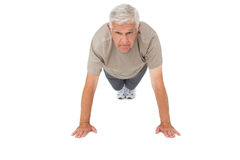Portrait of a senior man doing push ups Stock Photo