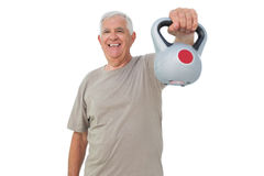 Portrait of a senior man exercising with kettle bell Stock Images