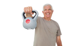 Portrait of a senior man exercising with kettle bell Royalty Free Stock Images