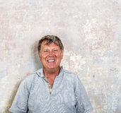 Portrait of senior man in front of grungy old wall Stock Photography