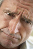 Portrait Of A Senior Man Frowning Stock Image