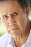 Portrait Of Senior Man Frowning At The Camera Royalty Free Stock Images