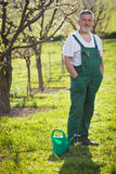Portrait of a senior man gardening in his garden Royalty Free Stock Images