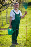 Portrait of a senior man gardening in his garden Stock Photo