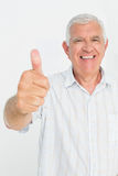 Portrait of a senior man gesturing thumbs up Royalty Free Stock Image