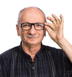 Portrait of a senior man with glasses Stock Photos