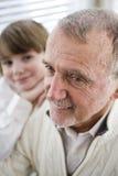Portrait of senior man with grandson. Focus on grandfather Stock Photo