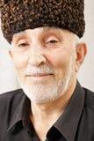 Portrait of senior man in hat Stock Images