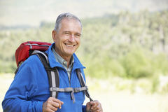 Portrait Of Senior Man On Hike Stock Photos