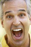 Portrait Of A Senior Man With His Mouth open. A Portrait Of A Senior Man With His Mouth open Stock Photo