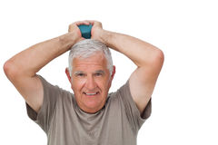 Portrait of a senior man holding dumbbell Stock Photos