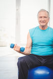 Portrait of senior man holding dumbbell Royalty Free Stock Photography