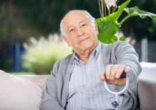 Portrait Of Senior Man Holding Metal Cane Royalty Free Stock Photo