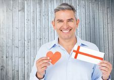Portrait of senior man holding red heart and gift card Stock Photography