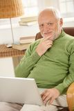 Portrait of senior man with laptop computer Royalty Free Stock Photography