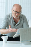 Portrait of senior man with newspaper Stock Photography