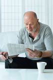 Portrait of senior man with newspaper Royalty Free Stock Images