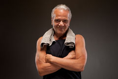 Portrait of a senior man posing with arms crossed Stock Image